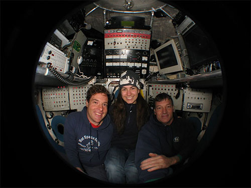 HWU researchers in a porthole window